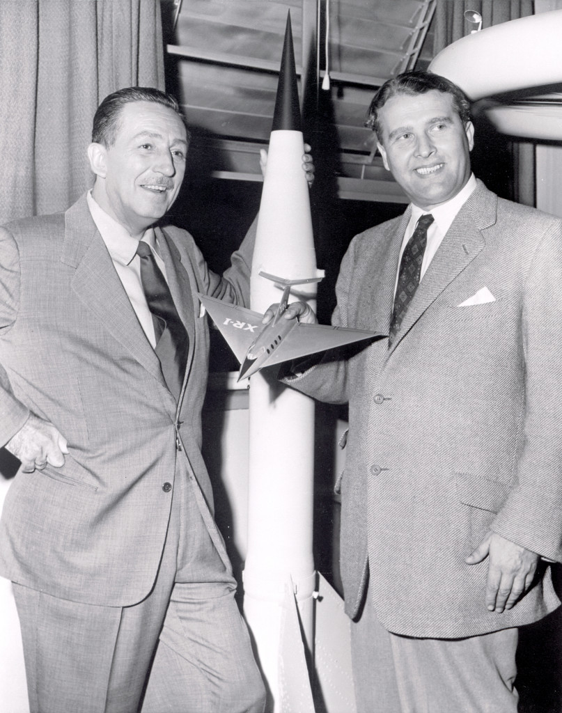 Walt Disney, left, and Wernher von Braun, right. Dr. Werhner von Braun, then Chief, Guided Missile Development Operation Division at Army Ballistic Missile Agency (ABMA) in Redstone Arsenal, Alabama, was visited by Walt Disney in 1954. In the 1950's, von Braun worked with Disney Studio as a technical director, making three films about space exploration for television. A model of the V-2 rocket is in background.